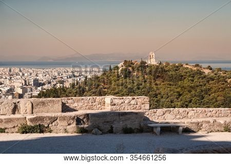 Athens Cityscape. View From The Acropolis To City, Philopappus Monument On Hill And The Aegean Sea E
