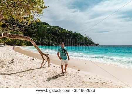 Seychelles Tropical Island, Young Man On The White Beach During Holiday Vacation Mahe Seychelles, Pr