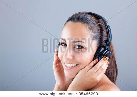 Smiling beautiful woman listening to music