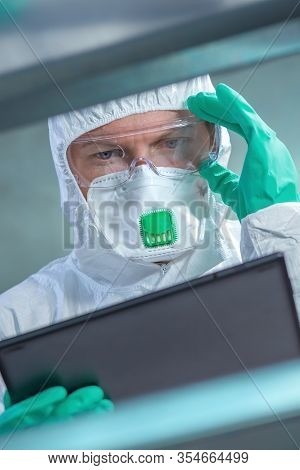 Virologist Healthcare Professional Using Tablet Computer In Laboratory, Close Up Of Medical Worker W