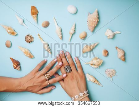 Beautiful Woman Hands With Pink Manicure Holding Plate With Pearls And Sea Shells, Luxury Jewelry Co