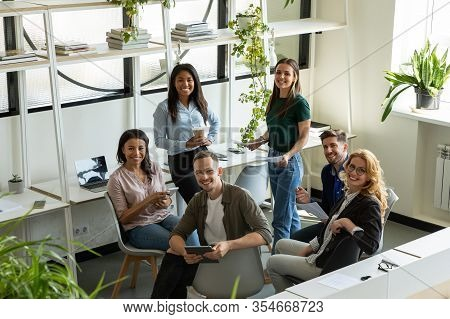 Happy Diverse Colleagues Discuss Ideas At Briefing
