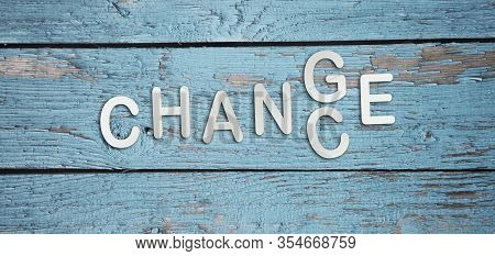 Word Change To Chance In Letters On Light Blue Wooden Background. Personal Development Career Growth
