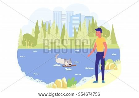 Teen Boy On Walk In Park With His Pet At Weekend. Dog With Stick In His Teeth Swims Ashore To Give I