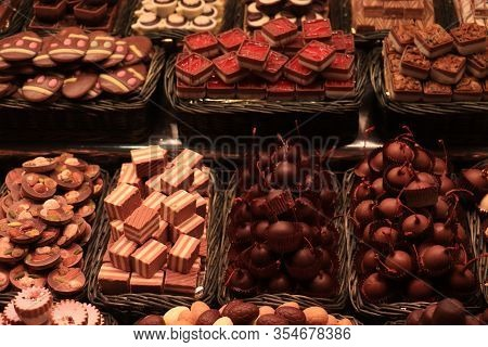 Chocolate Dipped Cherries And Luxurious Chocolate Pralines With Nuts At A Market In Barcelona, Spain