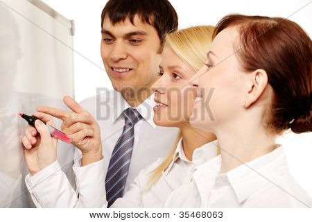 Positive office workers discussing new strategy