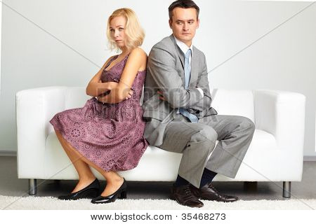 Unhappy young woman crossing her arms after the quarrel with her husband