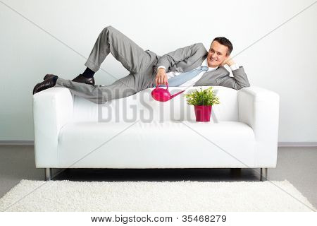 Conceptual shot of a cheerful businessman developing his newly-established business