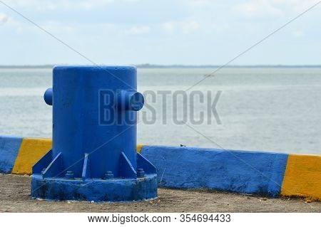 Blue Iron Mooring Bollard  On Seaport For Marine Moorings