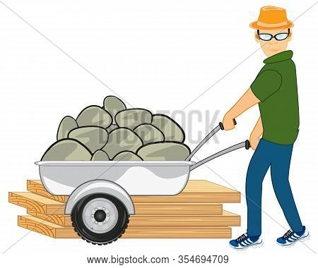 Man On Construction Site Carries Stone In Pushcart