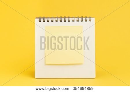 Blank Sticky Note With Copy Space To Put Text On Desktop Calendar On Yellow Background Using As Remi