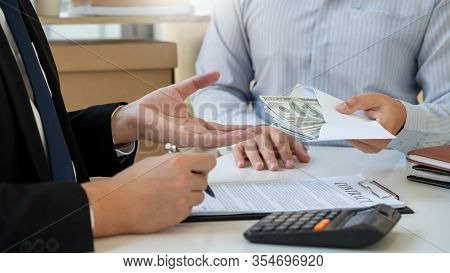 Bribery And Corruption, Businessman Hand Giving Money And Receive In The Envelope Offered File Disho