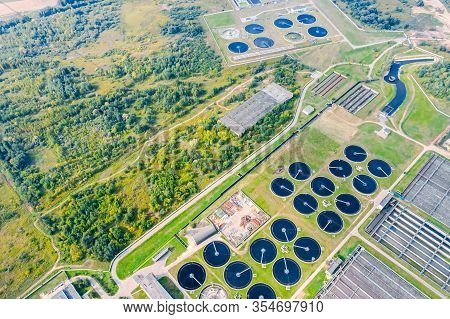 Sedimentation Tanks Of City Wastewater Treatment Plant. Aerial Photo From Flying Drone