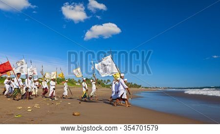 Bali Island, Indonesia - March 18, 2015: Balinese People Procession Walking By Beach With Hindu Scar