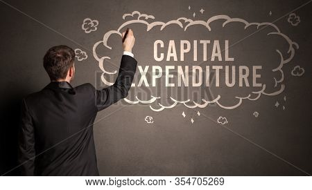 businessman drawing a cloud with CAPITAL EXPENDITURE inscription inside, modern business concept