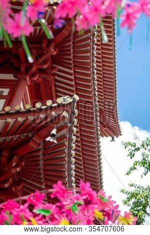Singapore, January 16, 2020, Buddha Relic Temple With Singapore Urban City Skyline With Beautiful La