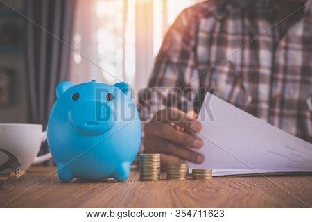 Businessman Holding Information Paper On Office Desk.