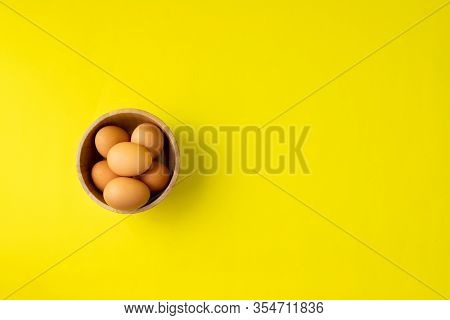 Copy Space On Yellow Background With Eggs.