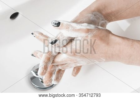 Effective Handwashing Techniques: Woman Washing Hand With The Between The Fingers Technique. Hand Wa