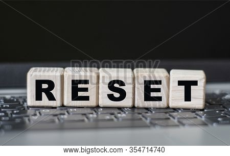 Concept Word Reset On Cubes On The Background Of A Laptop