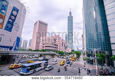 Taipei, Taiwan - May 15, 2019: View Of A Busy Street Corner In Downtown Taipei City At Rush Hour Wit