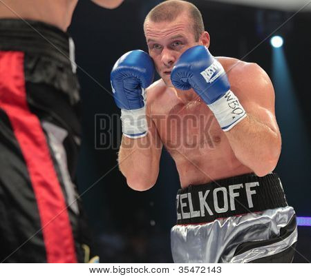 ODESSA, UKRAINE - JULY 21: Vyacheslav Uzelkov (pictured) vs Mohamed Belkacem in fight for WBO Inter-Continental light heavyweight title in Odessa, Ukraine at July 21, 2012