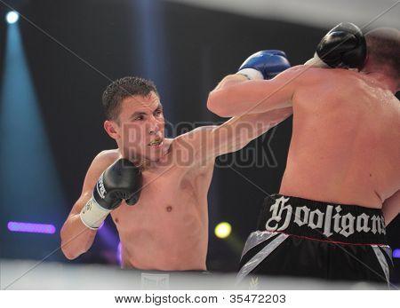 ODESSA, UKRAINE - JULY 21: Vyacheslav Uzelkov (right) vs Mohamed Belkacem in fight for WBO Inter-Continental light heavyweight title in Odessa, Ukraine at July 21, 2012