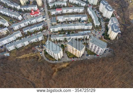 Aerial View Of Urban Environment, City Taking Place Of Nature. Expanding Flat Of Blocks Occupy Virgi