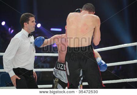 ODESSA, UKRAINE - JULY 21: Vyacheslav Uzelkov (in blue gloves) vs Mohamed Belkacem in fight for WBO Inter-Continental light heavyweight title in Odessa, Ukraine at July 21, 2012