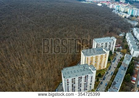 Drone View Of Urban Environment, City Taking Place Of Nature. Expanding Flat Of Blocks Occupy Virgin