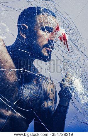 Handsome Brutal Man Near Broken Glass. Brutal Handsome Macho Focused On Fight Result. Want To Fight