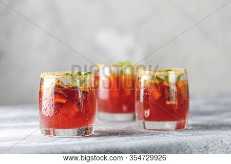 Three Glasses Of Campari Gin Spritz. Cocktail Of Sweet, A Touch Of Bitter From The Campari And Gorge