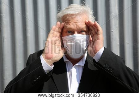 Coronavirus outbreak. COVID-19. A man wears a Paper Face Mask to avoid contamination of the dreaded Coronavirus2019. Coronavirus Cases: 105,994. COVID-19 Deaths: 3,570.  Be Careful and Stay Safe.