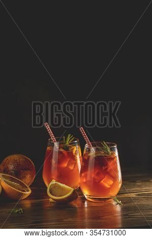 Two Glasses With Water Drops Of Campari Gin Spritz. Cocktail Of Sweet, A Touch Of Bitter From The Ca