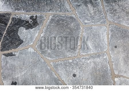 Top View Of Fresh Grouted Grey Flagstones As Background