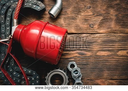 Red Oil Can And Car Spare Parts. Lubrication.