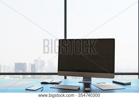 Modern Coworking Office Room With Panoramic City View, Computer With Blank Screen, Daylight And Equi