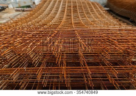 Rusty Fittings. Rusty Construction Metal Mesh. Rusty Metal Armature Net For Building Construction. M