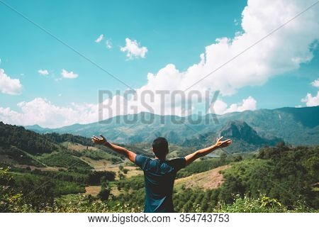 Man Raise Hand Up At Top Of Mountain On Blue Sky And White Cloud Abstract Background. Freedom Feel G