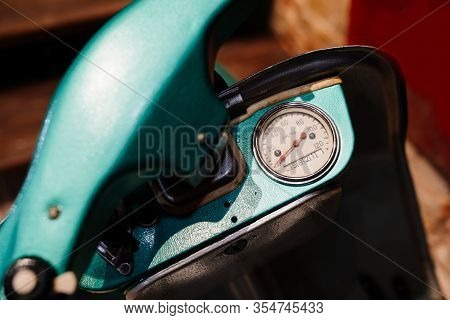 A Speedometer On A Turquoise Collectible Retro Moped.