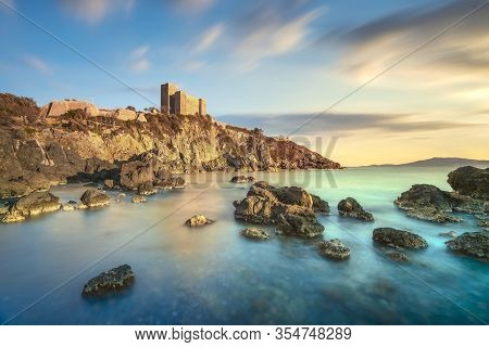 Talamone Rocky Beach And Medieval Fortress Rocca Aldobrandesca And Walls At Sunset. Maremma Argentar