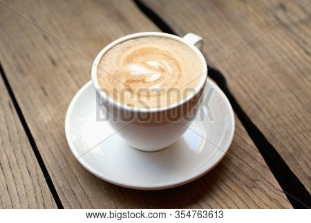Art Cappuccino In The Cup On The Wooden Surface.minimalist Beauty.cappuccino With Tasty Art Mug.