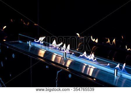 Fire In A Biofireplace. Modern Bio Fireplot Fireplace On Ethanol Gas. Smart Ecological Alternative T