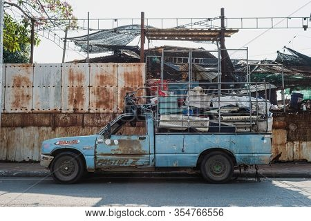 Chon Buri, Thailand - February 22, 2020: The Old Blue Pickup Car Is Packing Junk, Which Is Junk From