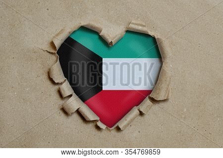 3d Illustration. Heart Shaped Hole Torn Through Paper, Showing Kuwait Flag