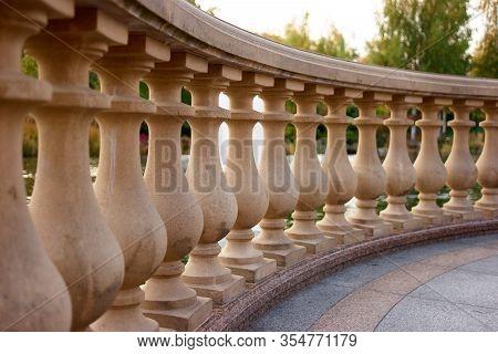 Row Of Stone Railings Close Up. Decorative Balustrade And Granite Floor.