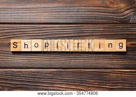 Shoplifting Word Written On Wood Block. Shoplifting Text On Wooden Table For Your Desing, Top View C