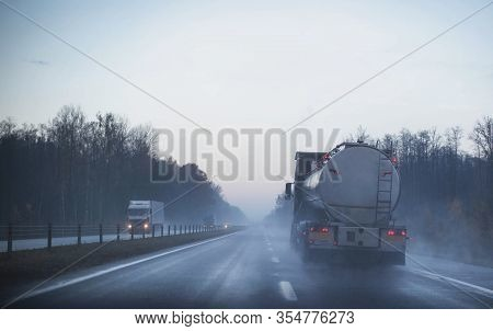 A Truck Wagon Rides On A Motorway In Fog And Rain. The Concept Of Poor Visibility On The Road, Copy