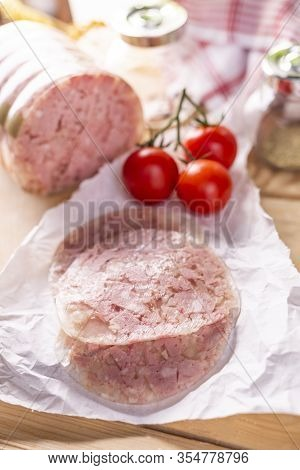 Sliced Headcheese On A Paper On A Wooden Worktop, Top View. Brawn. Pork Cold Cuts.