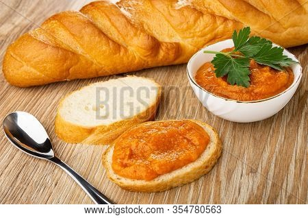 Loaf Of Bread, Slices Of Bread, White Bowl With Squash Caviar And Leaves Of Parsley, Sandwich With S